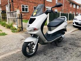 125cc peugeot maxi scooter I CAN DELIVER