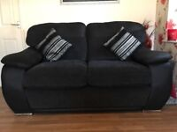 2 & 3 seater SCS sofa two years old black saude and black cord
