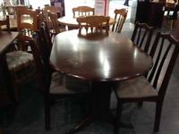 Mahogany extending dining table with 4 chairs