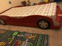 Red children's car single bed