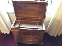 Antique wooden sewing cabinet, in great condition. Three drawers and storage under the lid.