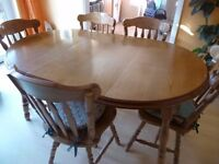 Wooden extending dining table with six chairs