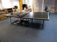 Table tennis table + net / loads of bats / balls - foldable! Good condition.