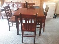 Mahogany kitchen table and 4 chairs (extends to seat 6).