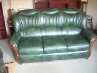 3 PEICE SUITE LEATHER (GREEN WITH WOODEN ENDS ). £100. can deliver locally