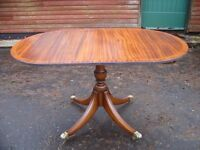 single pedestal drop leaf oval table, solid mahogany, brass castors, brilliant conditions, 4 seater