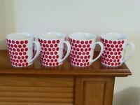 4 Mugs. White/red dots. M & S Fine China.