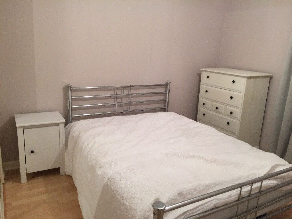 Silver metal double bed frame. Wooden slats