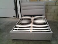 Double bed frame, natural colour fabric. Bargain, Delivery available.