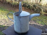 Antique galvanised watering can