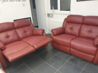 2x red leather recliner sofas