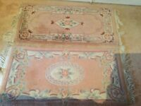 Two small rugs in coral/ taupe/ cream