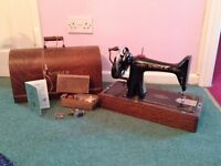 1931 Vintage gold and black Singer sewing machine with case. Excellent condition