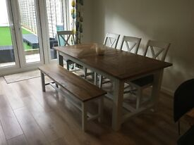 Extending kitchen/dining table, 4 chairs, 2 benches and a matching unit.