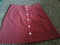 Burgundy mid thigh skirt -new condition