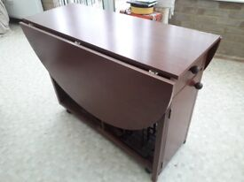 Fold down wooden dining room table and 4 chairs