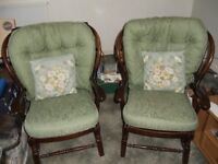 two homely old armchairs