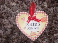 Heart shaped plaque saying 'Kate's Kitchen' Brand new with hanging loop & magnetic attachment too. D