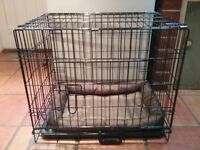Small dog crate with mat