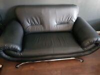 Black Leather Sofa. Seats 2.