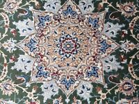 Beautiful persian rug in greens, reds and blues