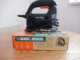 Black & Decker jig saw. Includes set of wood and metal blades.