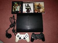 PS3 Super Slim 500GB with 2 controllers and 3 games