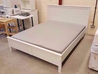 White IKEA king size bed frame with grey colour foam mattress