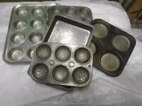 Baking trays and two cake tins