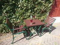 SET OF CAST IRON TABLE AND CHAIRS FOR A GARDEN, PATIO OR CONSERVATORY