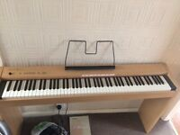 Electric Piano with pedals and music stand - Great Condition, light wood look and many features