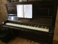 Piano free. Good learner instrument. No longer needed. Will need collection and bodies to lift!