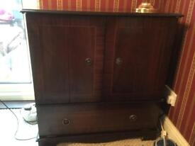Dark wood TV cabinet. Been used as drinks cabinet.
