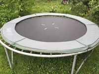 8ft sky high trampoline with Spring pad and poles/net