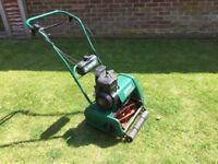Qualcast Classic Petrol 35s mower,in working order,detachable cassette for scarifier
