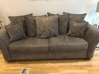 Sofa with cushions and storage footstoll