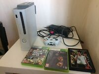 Xbox 360 that comes with cables and a control