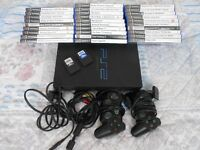PS2 console, 29 games, 2 controllers, 2 16MB memory cards, AV & Power cables - in full working order