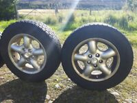 4 x alloys and 4x4 tyres 4 x 16 inch alloy wheels and tyres.