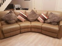 Tan Leather 4 Seater Semi Circular Sofa with 2 end Electric Recliners. Also 5 cushions, 3 Lge, 2 sml