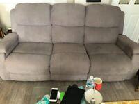 Grey three seater recliner sofa