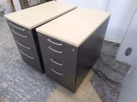 2 beech topped bedside cabinets with 4 drawers. immaculate. can deliver