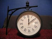 A Lovely medium size Garden wall clock in very good clean condition metal Black