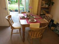 Scandinavian wood dining table with four chairs
