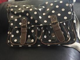 Black polka dot satchel bag