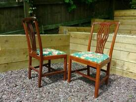 Two hand carved chairs