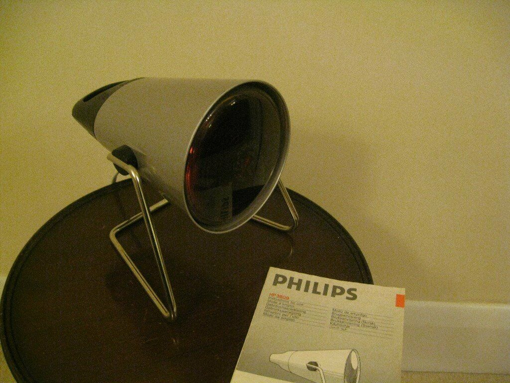 Heat lamp to help relieve aches and pains. This lamp is in excellent condition.