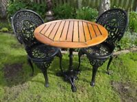 GARDEN / PATIO SET -- CAST IRON PEDESTAL BASE WITH WOODED SLATTED TOP + 2 CAST ALUMINIUM CHAIRS --