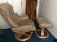 Leather swivelling recliner and matching foot stool