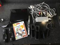 Black Nintendo Wii with accessories